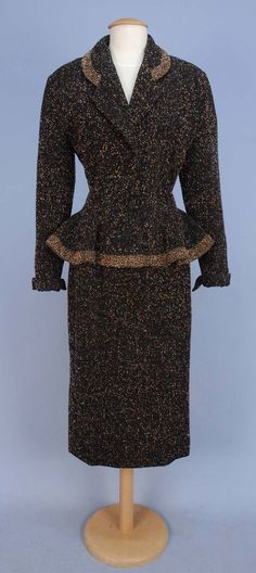 Lillian Ann peplum suit - another beautiful creation (circa 1950's). Black ribbed wool has multi colored flecks, jacket has rounded collar & ruffled peplum with contrasting trim band, winged turn back cuff, self buttons, silk lining and a matching pencil skirt with kick pleat.
