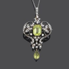 An early 20th century peridot and diamond brooch/pendant,