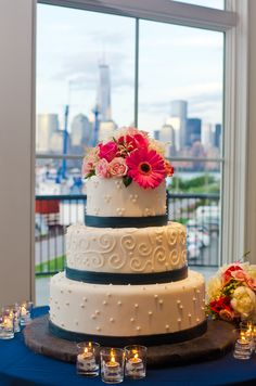 Three-Tier Patterned Wedding Cake with Navy Stripes and Coral Flowers