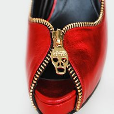 I love the detail on this pair of Alexander McQueens...and the red patent leather!