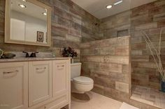 Love the shower minus glass. Need whole wall.