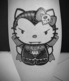 Hello Kitty vampire tattoo
