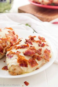 Cheesy Bacon Chicken Breasts - If you are a fan of cheesy bacon potatoes, then you are going to love these chicken breasts! The easiest recipe EVER with only THREE ingredients! Everyone loves delicious chicken recipes.