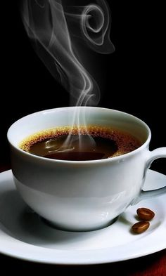 A cup of coffee smoking hot..black only