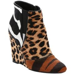 Christian Dior Tiger and leopard print calf hair 'Delta' wedge ankle... ($836) ❤ liked on Polyvore featuring shoes, boots, ankle booties, leopard booties, leopard wedge booties, leopard print booties, side zip boots and animal print boots