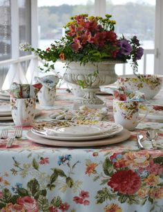 Blooming dishes and cottage floral tablecloth and centerpiece  | homeiswheretheboatis.net #tablescape #spring
