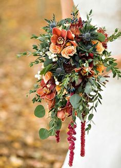 A bouquet with burnt orange flowers is the perfect complement to your fall wedding dress.
