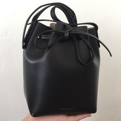 Mansur Gavriel Mini Mini Bucket Bag Only used a couple times, and will come with dust bag. Authentic and purchased from Steven Alan. This is the black/ballerina combo. Price is firm. Mansur Gavriel Bags