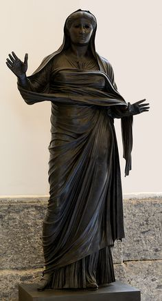 Presumably Livia, wife of Augustus, mother of Emperor Tiberius, Roman statue (bronze), 1st century AD, (Museo Archeologico Nazionale, Naples).
