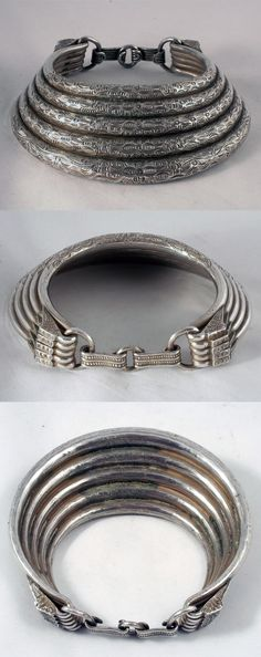 Golden Triangle (Laos / Burma / Thailand)   5 row torque from the Meo people   High grade silver; not hollow and heavy (1186 grs )   ca. early 20th century   4'950S$