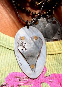 """Love heals"" recycled spoon necklace.  Love this!"