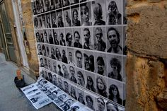 Street Art Photo Booth by Fabian David: The French street artist captured the portraits of 100 passers-bys in Lyon with a digital camera, printed the images and pasted them on a brick wall!