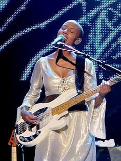 Gail Ann Dorsey--pop, rock (see her with David Bowie, Gwen Stefani and in 2011-2012 on tour with Lenny Kravitz). I've seen Gail favor a number of basses over the years, but Fenders and Ernie Ball Music Mans are steadies. As are Ampeg amps, particularly the SVT.