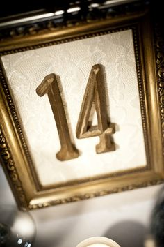 Gold and lace table numbers for weddings!