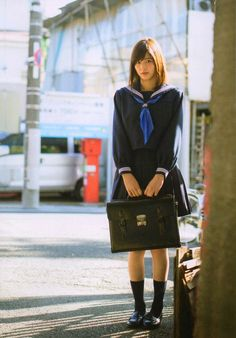 Leave in the morning with everything you own in a little black case, alone on a platform the wind and the rain on a sad and lonely face. Beautiful Japanese Girl, Japanese Beauty, Beautiful Asian Girls, Gorgeous Women, Japanese School Uniform, School Uniform Girls, High School Girls, Cute Girls, Cool Girl
