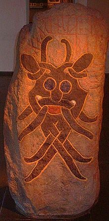 The Mask Stone (DR 66) found in Aarhus, Denmark commemorates a battle between two kings and features a stylized depiction of a mask.
