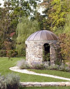 stacked stone folly with copper domed roof
