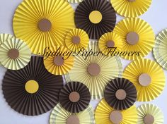 Paper fans backdrop - set of 20 in Chocolate and Yellow https://www.etsy.com/au/listing/260103538/honey-and-chocolate-paper-rosettes-baby