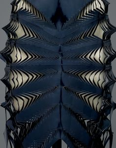 Iris Van Herpen (Dutch, born 1984). Dress (detail), spring/summer 2015, Prêt–à–Porter. Machine–sewn, laser–cut, bonded navy patent leather. Photo © Nicholas Alan Cope. #ManusxMachina #CostumeInstitute