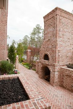 A beautiful courtyard includes many features in brick, including a fireplace, pizza oven, and a fire pit for calmer days...