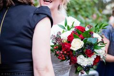 Happy Winter Bride and lovely red bouquet