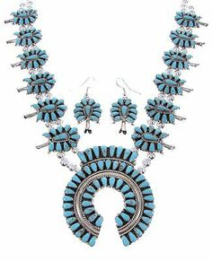 "Turquoise Squash Blossom Navajo Necklace Earring Set GS61331 SilverTribe. $899.99. MEASUREMENTS: Necklace measures approximately 26"" inside circumference allowing the side links to measure 7/8"" long and 1-1/4"" wide, while the center piece measures 2-5/8"" long and 2-1/4"" at widest point. The necklace weighs 115 grams. Hook dangle earrings measure approximately 2"" long (including hook) and 7/8"" at widest point.. MATERIALS: Sterling silver and Turquoise.. Turquois..."