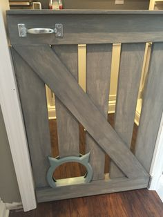Cute modern barn door with the kitty pass interior cat door - love this!!! I want to do this when we have kids
