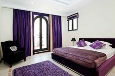 Bedroom Create A Small Bedroom Feel Larger: Beautiful Bedroom Design With  Platform And Pillows And Blanket And White Flooring Tiles And Purple Rug  And Black ...