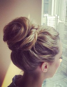 Nothing's better than a messy chic hairstyle to dress down an outfit. This top knot pulls together many twists and turns.