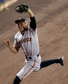 San Francisco Giants' Hunter Pence catches a long fly ball hit by St. Louis Cardinals' Jon Jay during the first inning in Game 2 of the National League baseball championship series Sunday, Oct. 12, 2014, in St. Louis. (AP Photo/Eric Gay)