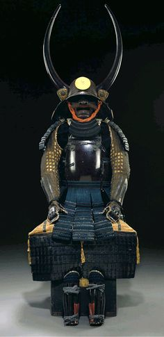 Kuronuri Hotoke Do Gusoku (Black-lacquered Armor) Edo period (17th century) The maedate (forecrest) of a gilt-metal sun, and the wakidate (side crests) of black-lacquered wood simulating oxhorn. Accompanied by a certificate of registration as a Juyo bunka shiryo (Important cultural material) no. 464 issued by the Nihon Katchu Bugu Kenkyu Hozon Kai (Japanese Armor Preservation Society)