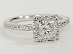 Delicate in design, this diamond engagement ring showcases micropavé-set diamonds to frame the Princess Cut diamond of your choice.