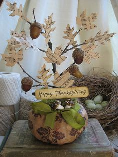 Cute idea to make old sheet music into leaves for a fall table centerpiece.