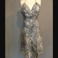 FINAL SALE!! Express Cheetah Dress Black and gray cheetah print dress. Backless. Monroe style. Worn once. Adorable! Great for dates and other dressy events! Express Dresses Mini