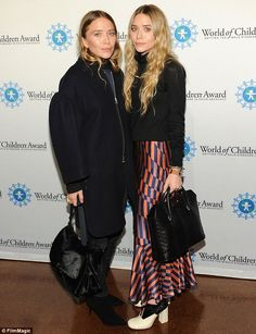 Stylish siblings: Mary-Kate, left, and Ashley Olsen, right, arrived showed off their disti...