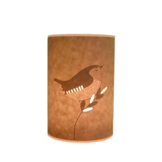 Hannah Nunn Little Wren Candle Cover: When a lit tea light candle is placed inside this wren candle cover, a warm, ambient glow flickers through the parchment highlighting the design. The design is cut from paper, finished by hand and laminated for strength and durability.