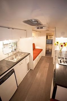 1967 Airstream Overlander - The interior living space offers two beds – a dinette in front that converts to a large bed (88″ x 49″) and a single bed (76″ x 32″) in the back.
