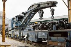 Washington Terminal Co. Heavy Wrecking Crane #500, built by Industrial Works in Bay City, Michigan in 1913. This steam-powered crane was used to clear tracks or re-seat cars when a train derailed. It could lift as much as 120 tons. the flatcar next to it carried a set of trucks.
