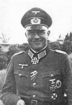 """General der Infanterie Friedrich-Wilhelm Müller (29 Aug 1897 – 20 May 1947) brutal commander of occupied Crete, earning nickname """"The Butcher of Crete."""" Postwar tried, convicted and executed for war crimes. Knight's Cross on 22 Sep 1941 as Oberstleutnant and commander of Infanterie-Regiment 105; 86th Oak Leaves on 8 Apr 1942 as Oberst and commander of Infanterie-Regiment 105; 128th Swords on 27 Jan 1945 as General der Infanterie and commanding general of the LXVIII. Armeekorps"""