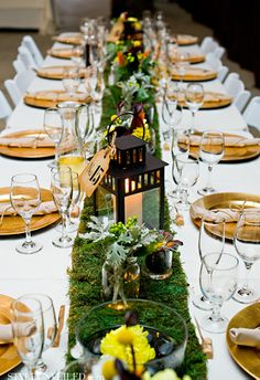 Change white table cloth to dark color, moss runner to lace, and gold chargers to silver.