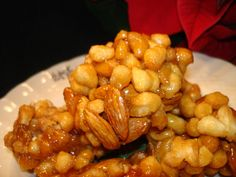 Pignolata, these are more similar to the recipe my grandma used to make with almonds and then stacked high,