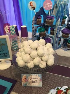 Donut snowballs at a Frozen birthday party! See more party ideas at CatchMyParty.com!