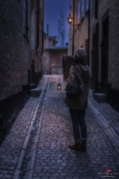 The Old Town... - A girl with a lantern...In Gamla Stan (the Old Town), Stockholm, Sweden.