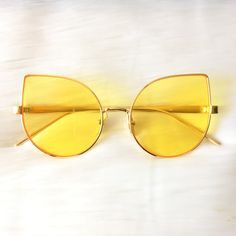 · Cateye Shaped Sunglasses · Gold Metal Detailing · Gold Metal Nose Guard