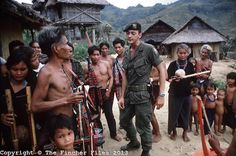 American Special Forces seen during a visit to make friends with the local tribe of Montanards in the Central Highlands of Vietnam during the war. April 1970. Photographed by Terry Fincher