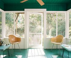Screened in porch. Green floors, green ceiling, white walls. #light #air Photo by Roger Davies.