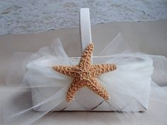 This beautiful handmade Starfish Flower Girl Basket is the perfect touch for any tropical or beach theme wedding. The wood basket is hand painted