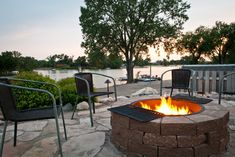 13 Upgrades For Your Outdoor Grill Area: Cook campfire-style. Forgo the fancy grill entirely in favor of a stone fire pit with attached grilling grates.