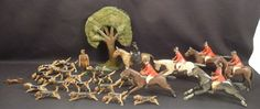 "Forest Toys Hunt Scene  ""Forest Toys"" were produced in Brockenhurst, in the New Forest area of England between World War I and II.  Frank Whittington was an artist and wood-carver who started making toys after his return from WWI.  Demand increased and he was soon employing others to help turn out the toys.  Whittington's designs were inspired by the animals he observed in New Forest and from frequent visits he made to the London Zoo and Natural History Museum."