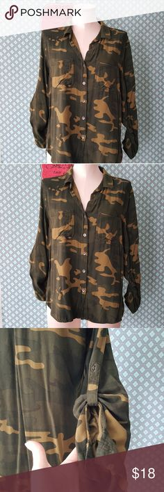 Army camoflauge button down top soft sz med Army camoflauge button down top soft sz med by rock and republic  Sleeve can be worn 3/4 with tab  No visable signs of wear or damage    Pre owned condition *******All items are in pre owned condition, Nothing, unless noted , is brand new **** please ask questions For sale in my posh closet  LINK IN MY BIO Rock & Republic Tops Button Down Shirts